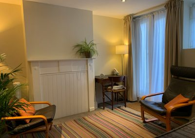 Spacious, bright room with 2 armchairs, table and chair